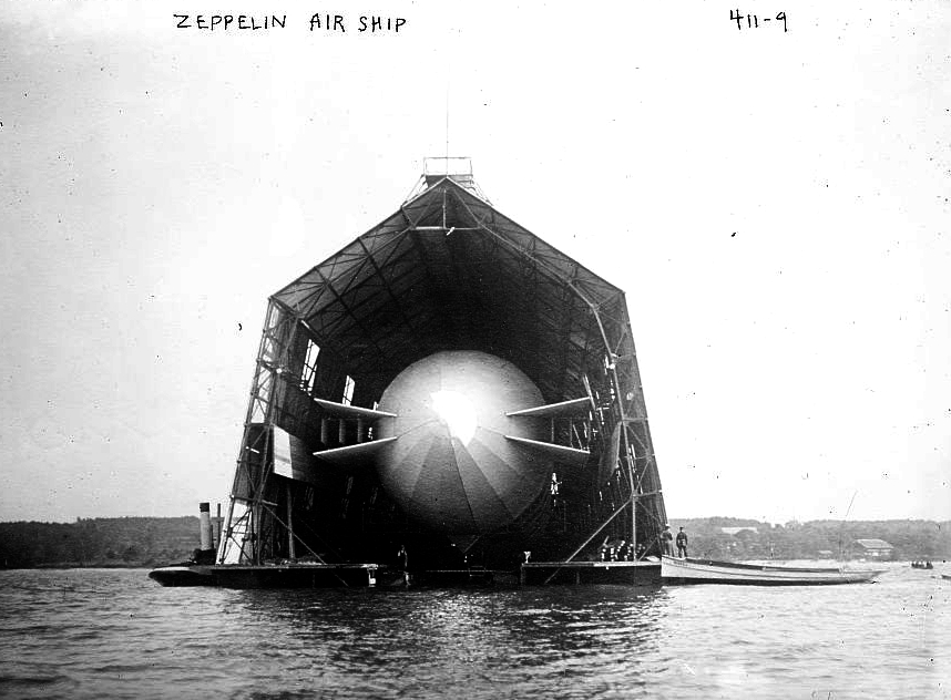 A zeppelin parked in a floating hanger prior to the war