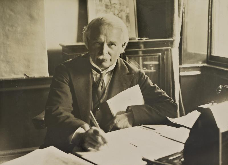 A press photo of Chamberlain David Lloyd George at work in his office