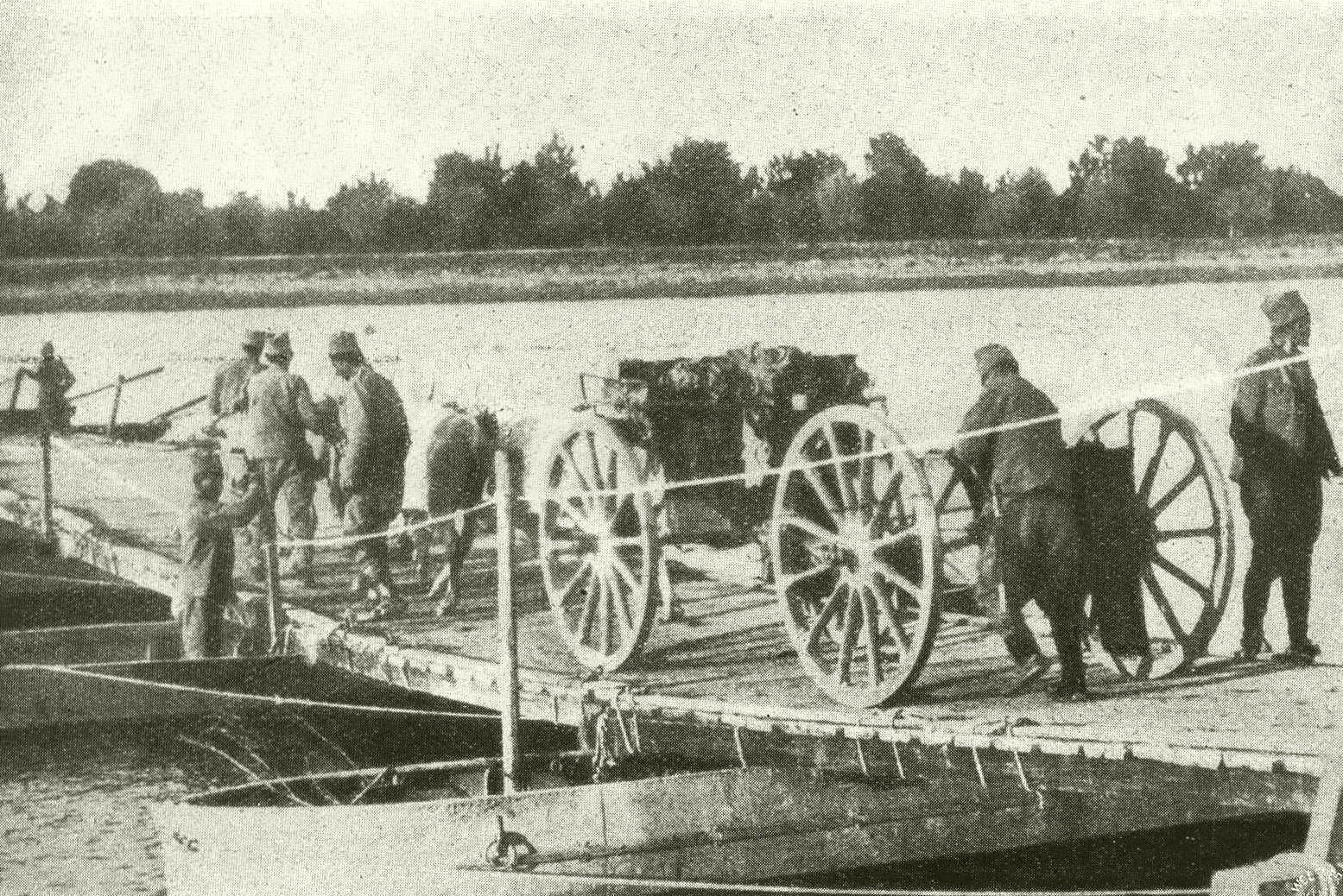Serb troops crossing a pontoon bridge on the Drina