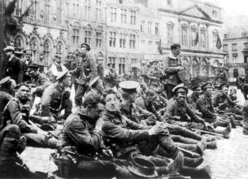 Men of A Company, 4th Battalion, Royal Fusiliers resting in the center of Mons shortly before the BEF's first battle with Germany