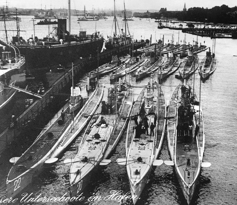 U-21, the first German submarine to sink a British warship, is on the right. U-17 is next to her, second from the right
