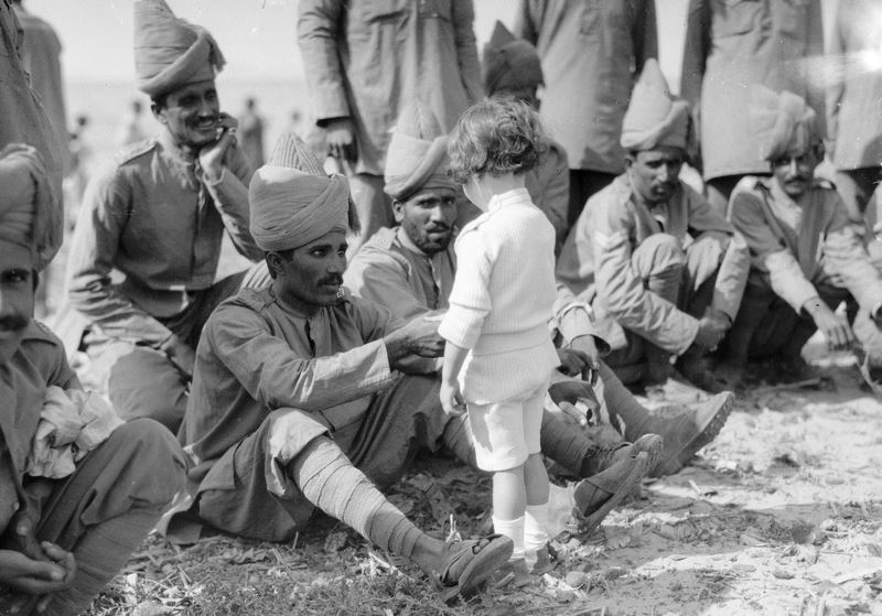 A French child meets Indian troops after their disembarkation on September 30