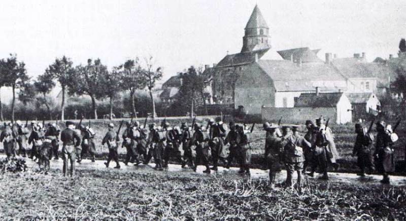 French troops marching past the church of Zonnebeck, early October 1914