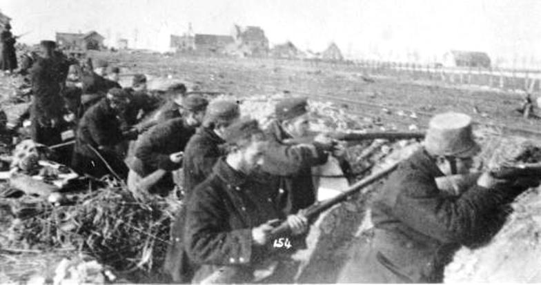 Belgians prepare to fend off a German morning attack in October. Note the fence in the field, which will later be flooded