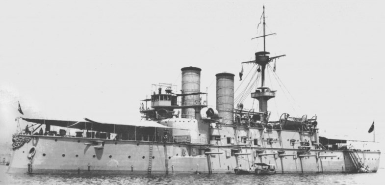 The Mesudiye was an ironclad converted into a pre-dreadnaught battleship. The deck turrets are unseen in the awning's shadow in this photo, but note the gun sponsons in the side