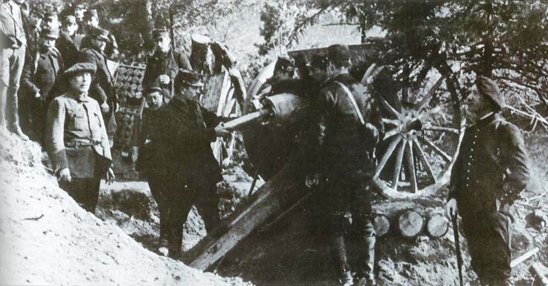 A French 75mm gun crew near Steinbach. Note the gun has been raised to elevate the barrel