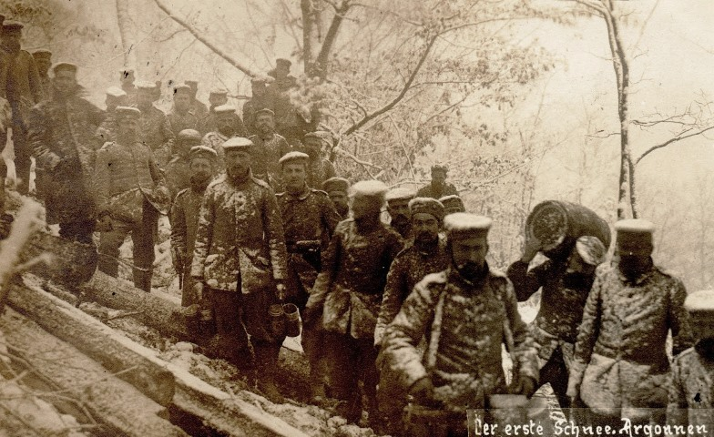German troops lined up on a snowy reverse-slop to receive rations