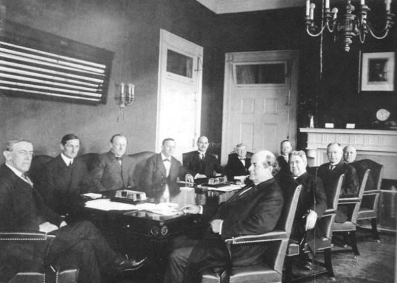 Wilson (left) and his cabinet in 1915. Secretary of State William Jennings Bryan sits third from the left