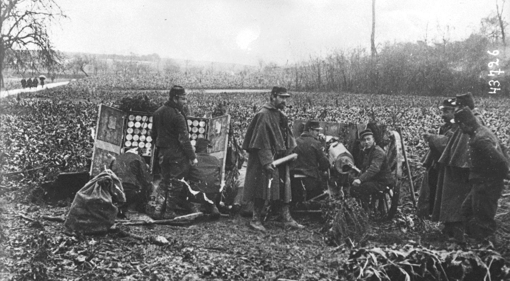 A French 75mm gun crew in action near the Ardennes in August. Note the caisson designed to allow for rapid-firing of up to 72 rounds