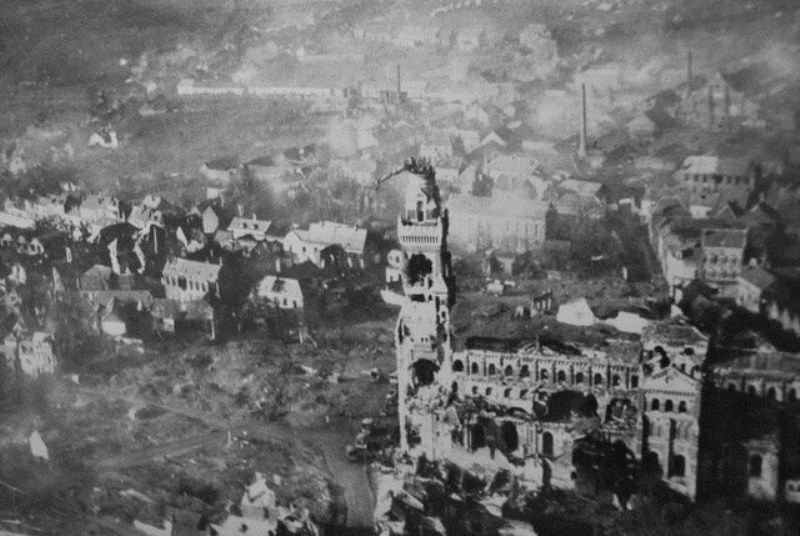 The devastated city enter of Albert. French engineers arrested the fall of the Madonna and child statue on the steeple; both sides joked that the war would end when it fell