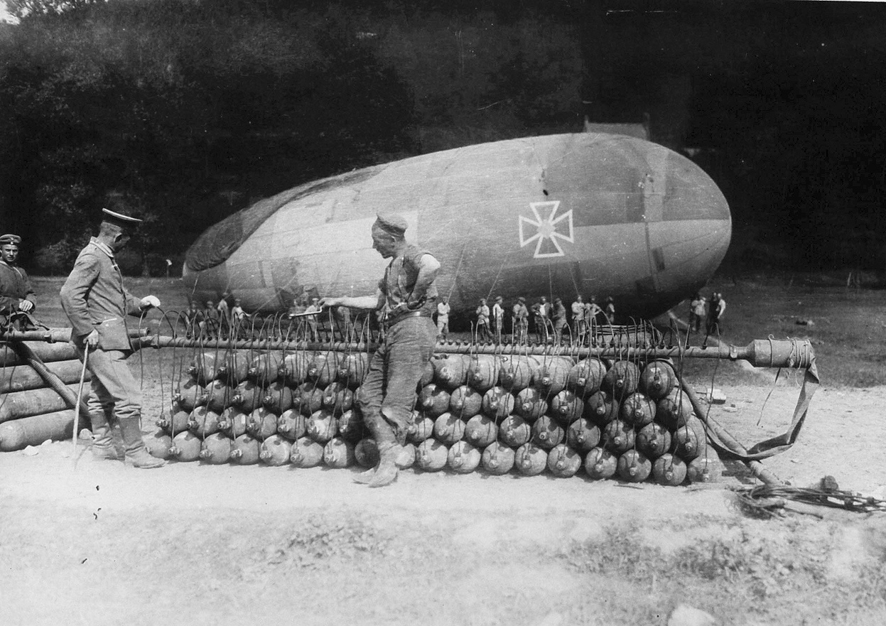 A German artillery observation balloon on the ground with hydrogen gas canisters in the foreground. Note the big markings to prevent friendly pilots from accidentally shooting it down