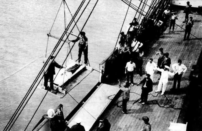 A wounded sailor from the Pegasus being transferred to the Hospital ship Gascon