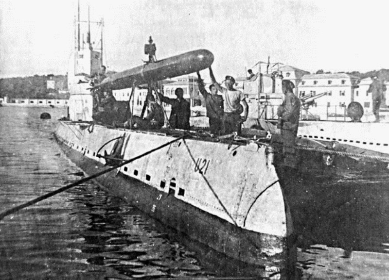 U-21 taking on torpedoes in harbor. The technology was new enough that they often missed