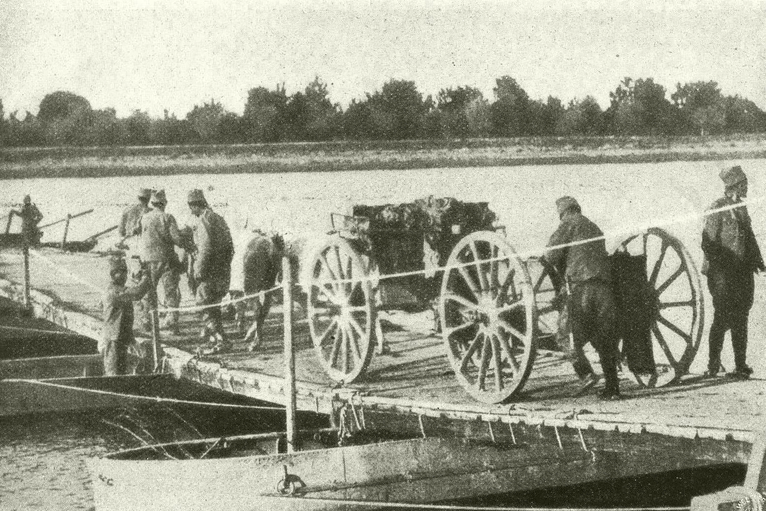 Serb troops crossing a pontoon bridge on the Drina