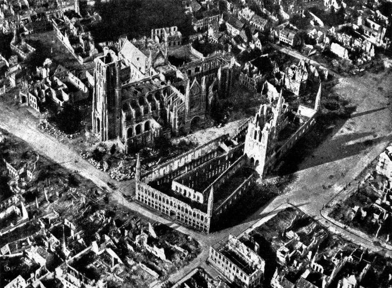 The medieval cloth hall of Ypres in 1915. Shellfire has destroyed all the roofs  and damaged all the walls of the city center
