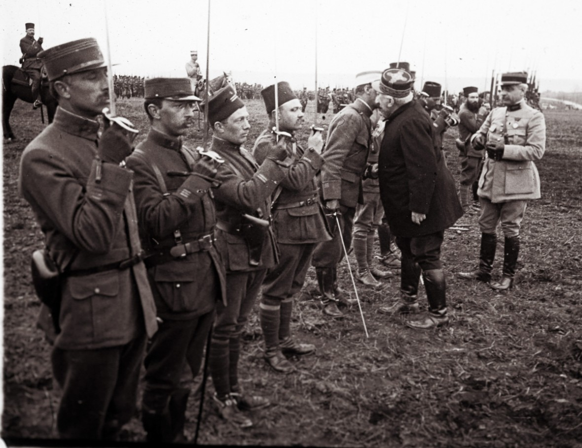 Joseph Joffre's unique embroidered field cap is visible as he awards medals in 1916