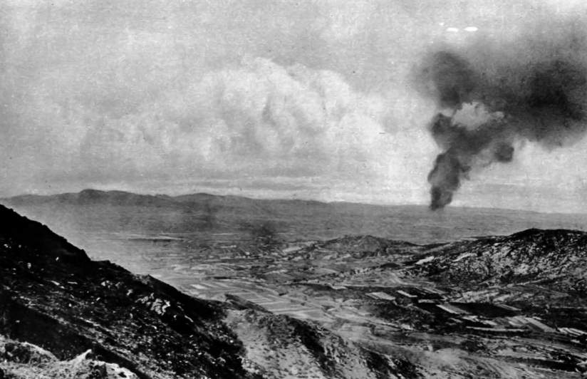 A view of Tsingtao from Japanese positions after shells set the oil tanks afire