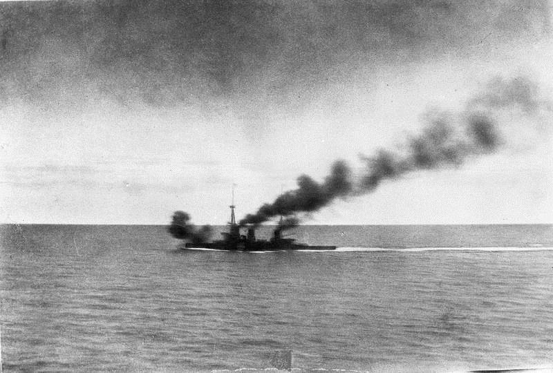 The HMS Inflexible opens fire on