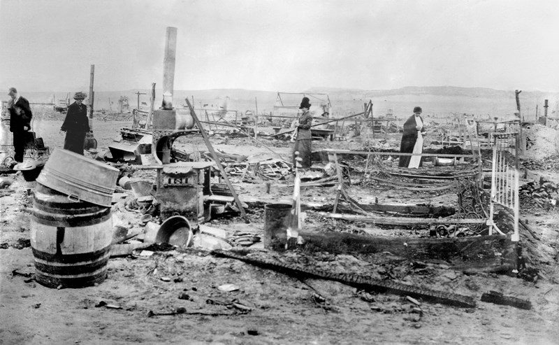 The burned-out remains of the striking miners' camp at Ludlow, Colorado. On April 20th, 1914, the state's reactionary governor ordered the National Guard to attack 1,200 United Mine Workers and their families