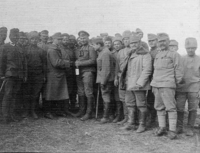 Russian and Austrian troops fraternizing ca. 1917. Note the bottle of alcohol, which was forbidden to Russian troops. Such meetings were encouraged by the Central Powers as a means to 'soften' their enemy with booze