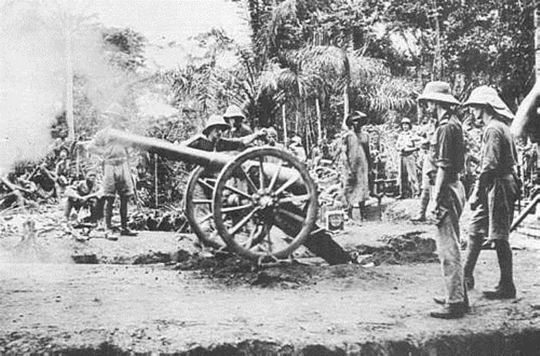 A British 12-pounder field gun in action later in 1915. Note how a hole has been dug under the tow end to achieve a higher angle of fire