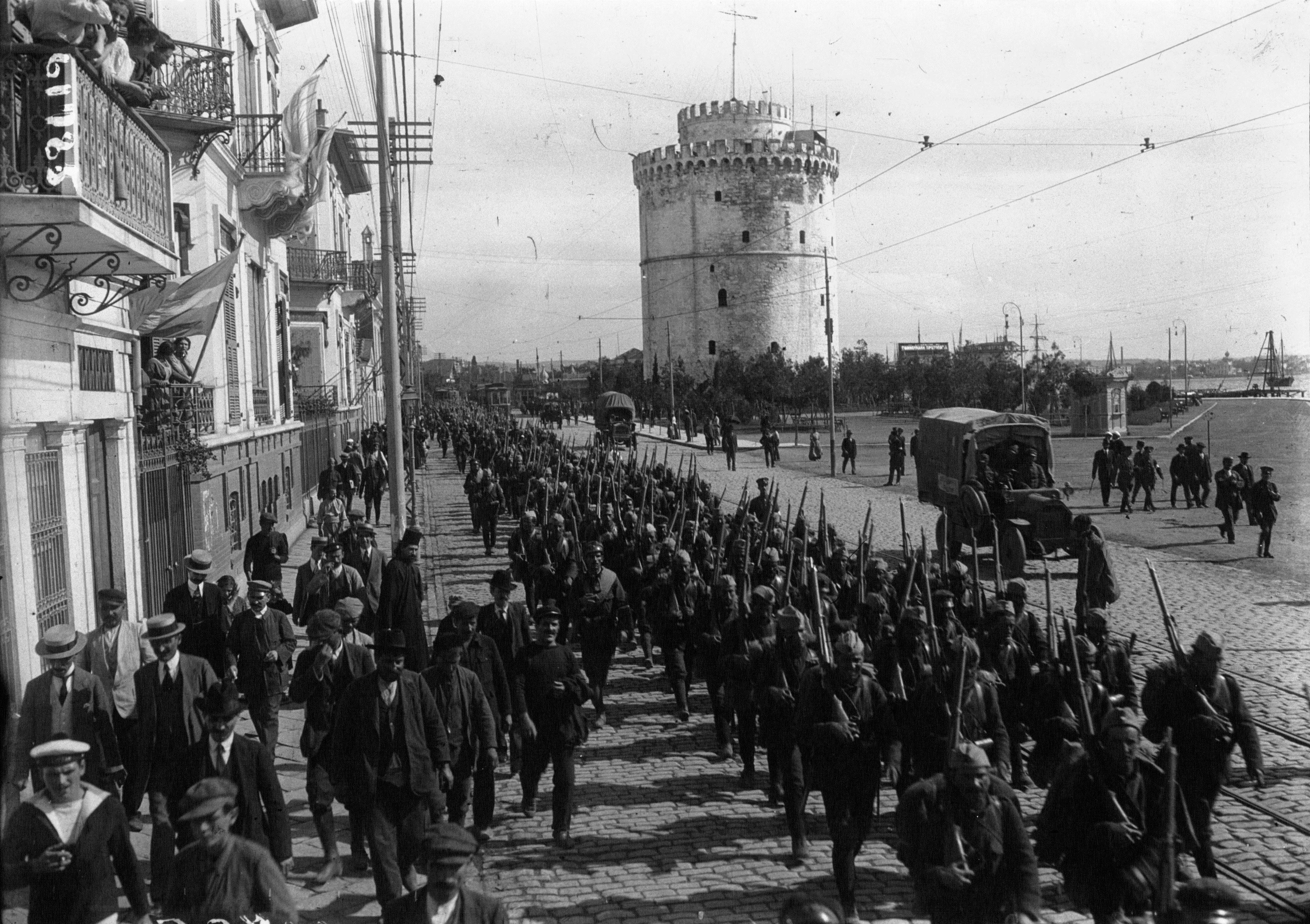 The National Defense Army finally marches to war in 1917. Note the motor vehicles and rails