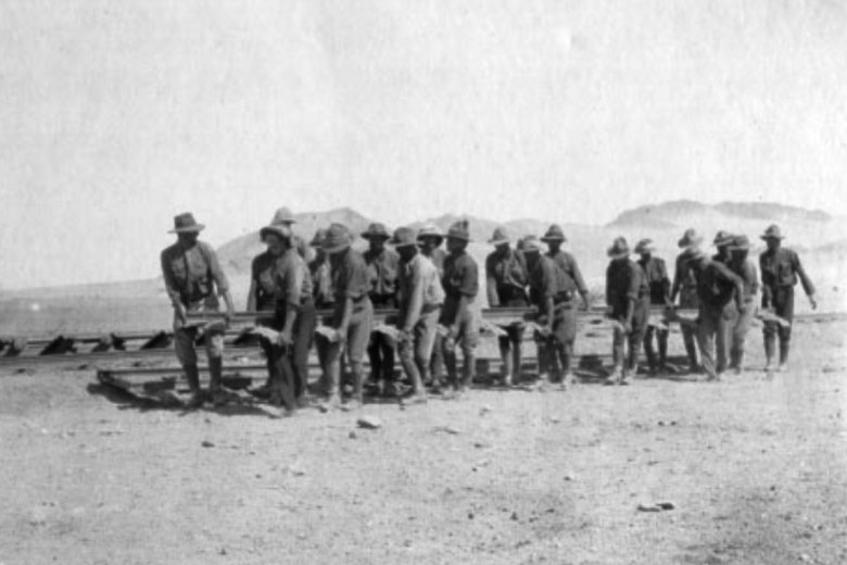 South African troops laying a narrow-gauge railroad between Rossing to Jakals Water