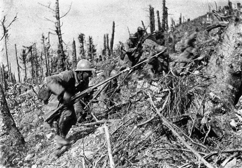 """An infantry """"charge"""" uphill in the Argonne, October 1915. Note the newly-issued Adrian helmets"""