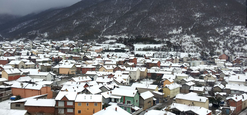 Modern-day Zhur, Kosovo in wintertime. Note the steep terrain; in West Virginia, this would be called a 'holler'