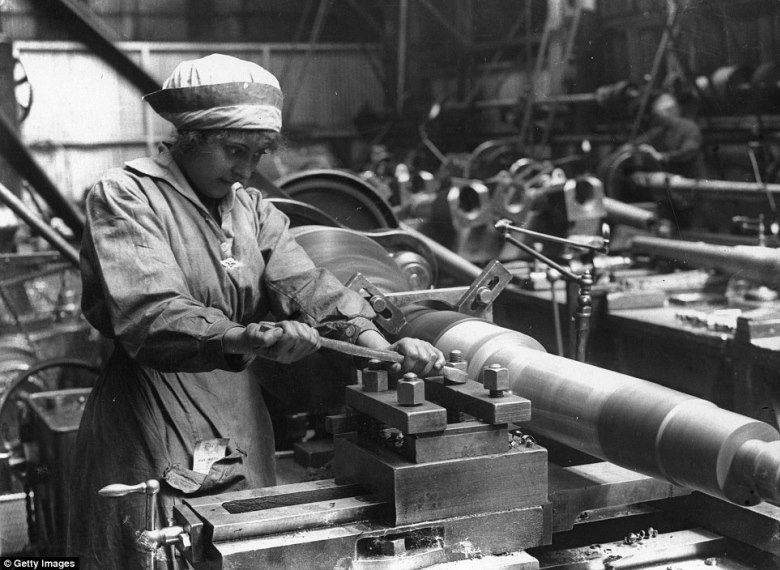 Hundreds of thousands of British women would work in all kinds of occupations during the Great War, with permanent effects on female fashion. Note that her hair is cut short for safety around the spinning lathe